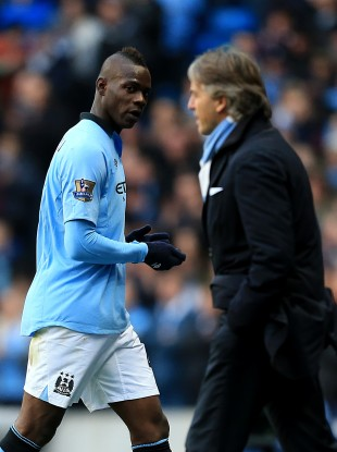 Balotelli glances over at Mancini while being substituted.