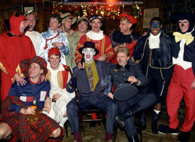 The Liverpool players (including Steve Staunton, far right, back row) dress up for their night out in 1990.