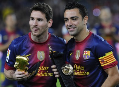 Messi (left) and Xavi are both products of the Barcelona youth system.