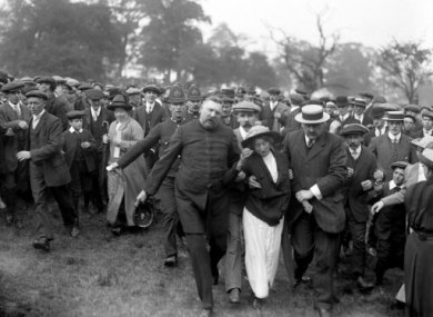 A suffragette being removed from a meeting addressed by Lloyd George in 1913.