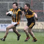 Crossmaglen Rangers have to cope with all sorts of obstacles in their pursuit of All-Ireland glory. Here the Armagh club giants attacker Tony Kernan shakes off the challenge of Dr Crokes Keith McMahon in wretched weather conditions in Portlaoise. At the end of a tough game, they march on to another final with three points to spare. (INPHO/Lorraine O'Sullivan).