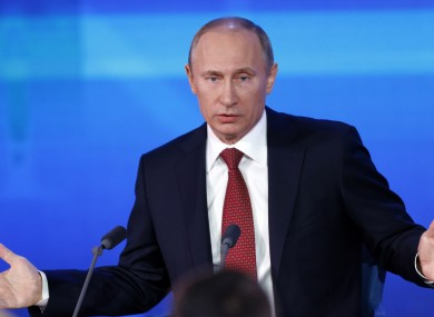 Russian President Vladimir Putin speaks during a news conference in Moscow, Russia