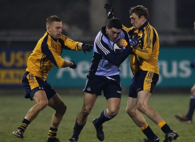Dublin's Bernard Brogan tackled by Johnny Cooper and William Lowry of DCU.