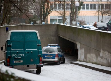 Police cars stand at the entrance of the underground parking lot where the entrace to the tunnel was located.