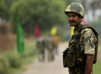 File photo of Indian Border Security Force soldier keeps alert at the India Pakistan border.