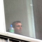 Jim McGuinness opts for shelter behind a window rather than prowling on the sideline.