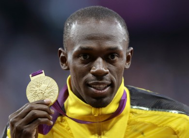 Bolt is pictured after winning gold in the 100m final.