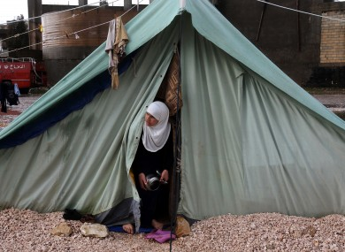 A Syrian refugee woman looks outside her tent, at a temporary refugee camp in the eastern Lebanese town of Marj near the border with Syria, Lebanon
