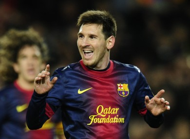 FC Barcelona's Lionel Messi from Argentina celebrates scoring his side's fourth goal against Espanyol.