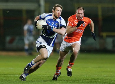 Laois man Billy Sheehan and Ciaran McKeever of Armagh.