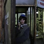 Semsa Hadzo, a Bosnian coal technologist, speaks on the phone while waiting to begin her 8-hour shift.