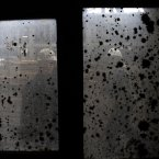 Miner Sakiba Colic and one of her colleagues are seen through a smeared window outside the shaft of the coal mine in Breza.