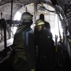 Sakiba Colic, right, and Semsa Hadzo, left, Bosnian coal technologists, ride a coal mine train on the way out of the shaft at the end of their 8-hour shift.