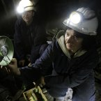 Coal miners Sakiba Colic, left, and Semsa Hadzo, right, Bosnian coal technologists, are checking air flow and temperature at 450 meters underground in the shaft of the coal mine.