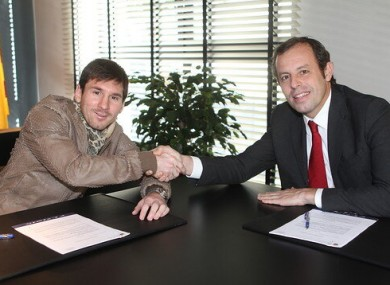 Messi and Barca president Sandro Rosell.