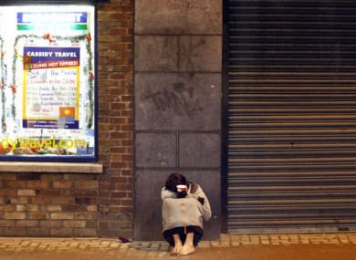 Shoeless beggar in Dublin.