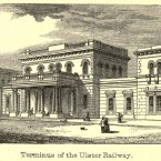 Great Victoria Street Railway Station, Belfast. The Ulster Railway opened Belfast's first railway terminus in 1839. By 1852 the Dublin and Belfast Junction Railway was completed, making it the terminus for the most important main line in Ireland. The Ulster Railway had added a new station building in 1848 to designs by John Godwin, replacing the original station by Thomas J. Woodhouse. Sadly, in the early 1970s Northern Ireland Railways closed both Great Victoria Street and the Belfast Queen's Quay terminus of the Bangor line and replaced them with a new Belfast Central station. The station buildings were demolished and the Europa Hotel and the Great Northern Tower built in its place. For many years, part of the railway shed remained, in use as a bus station, before being demolished. (Image: Archiseek.com)