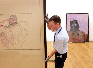 Hugh Lane Gallery attendant Peader Fitzgerald packs up Francis Bacon paintings being moved t