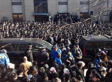 Crowds gather at a synagogue in Brooklyn where funeral services were held yesterday Nachman and Raizy Glauber.
