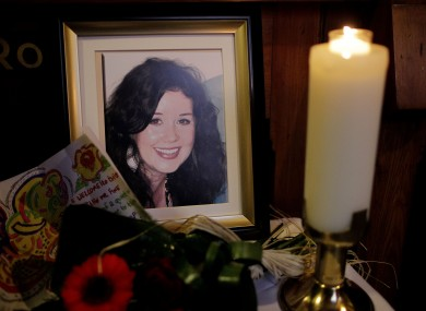 A candle burns during a Memorial Mass for murdered Irish woman Jill Meagher (seen in framed photo) at St Peter's Church, Drogheda, Co Louth (file photo).