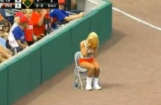 Hooters ballgirl interrupts baseball game after mistakenly grabbing live ball