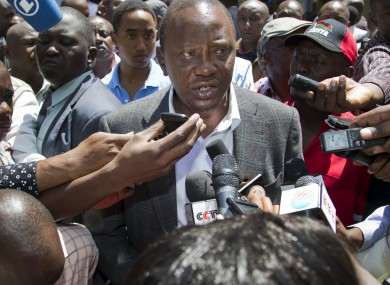 Kenyan Presidential candidate Uhuru Kenyatta speaks to the media after casting his vote earlier today.