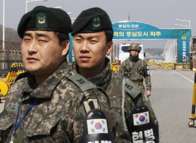 South Korean Army soldiers stand guard at the Unification Bridge near the border village of Panmunjom in Paju, South Korea, today.