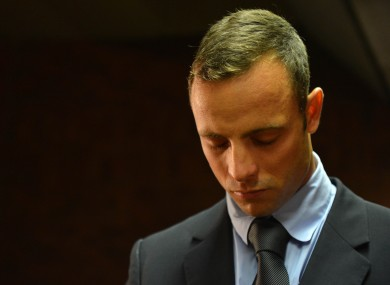 Oscar Pistorius enters court.