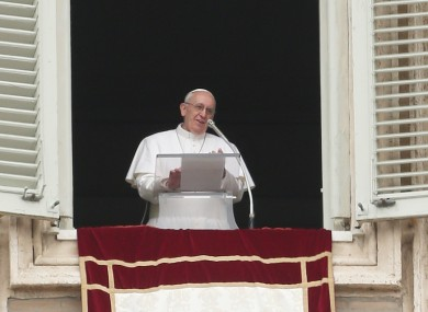 Pope Francis delivers his Angelus prayer from the window of his studio overlooking St. Peter's Square, at the Vatican.