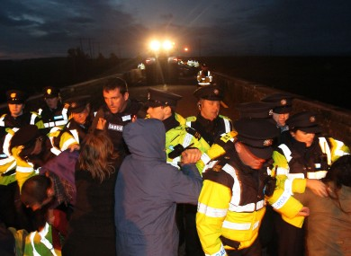 Shell to Sea activists clash with Gardai after they blocked the path of a convoy containing Tunnel Boring Machinery on its way to the Shell Bellanaboy Gas refinery in Co Mayo.