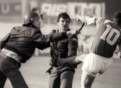 Dinamo Zagreb's Zvonimir Boban, right, clashes with police in 1991.