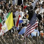 Pope Francis wave to the crowd in St. Peter's Square at the Vatican.  (AP Photo/Andrew Medichini)