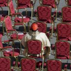 A cardinal sits in St. Peter's Square at the Vatican. (AP Photo/Andrew Medichini)