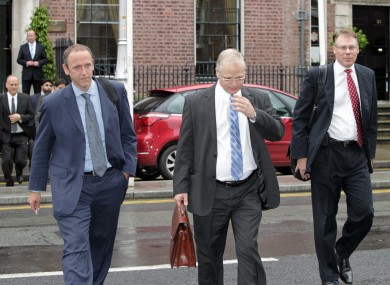 Officials from the Troika in Dublin last summer