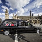 A hearse carrying the coffin bearing the body of Margaret Thatcher arrives at the Palace of Westminster.