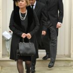 Carol Thatcher, her partner Marco Grass (centre) and Michael Thatcher (right) leave the home of Margaret Thatcher in Chester Square, Belgravia, on their way to her funeral service at St Paul's Cathedral, central London.