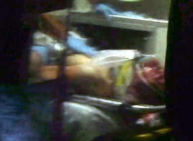 A grab from a video shows Dzhokhar Tsarnaev in an ambulance after being captured following a police manhunt on Friday.