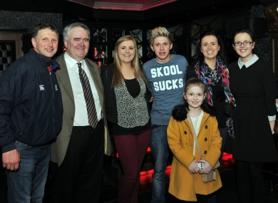 Niall Horan (in the 'Skool Sucks' top), Willie Penrose (beige suit), and pals