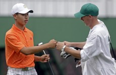 Controversial penalty leaves 14-year-old Guan in danger of missing historic Masters cut