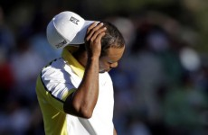 Jason Day leads Masters as Woods falters