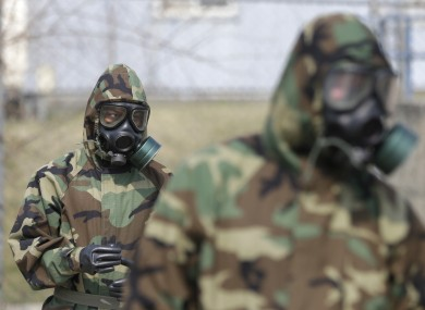 Soldiers of the US Army 23rd chemical battalion wear gas masks while attending a demonstration of their equipment in South Korea today.