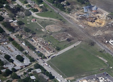 Aerial photo shows the remains of a nursing home, left, apartment complex, center, and fertilizer plant, right, destroyed by an explosion in West, Texas