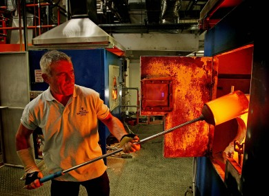 Glass blowers try to keep the furnace at the Waterford Crystal plant active while they continue a sit-in in 2010, hoping to safe the factory.