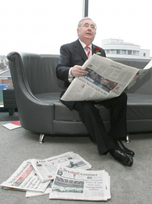 Pat Rabbitte reading newspapers at Labour's annual conference in 200