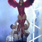 Jennifer Lopez looks a little bit like she's trying to hold in a fart here, which is understandable given the location of her arse in relation to the dancers' faces.  Chris Pizzello/Invision/AP