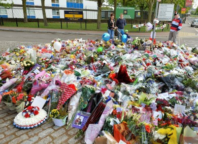 Floral tributes outside the main gate of the Royal Artillery Barracks in Woolwich, south-east London, near to the spot where Drummer Lee Rigby was hacked to death on Wednesday.