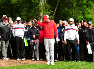 Rory McIlroy takes a drop during his round of 74.