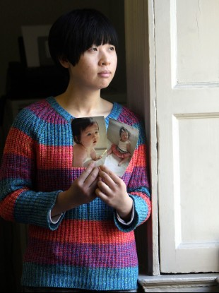 Meijiao Yu holds a picture of her daughter Jiayi.