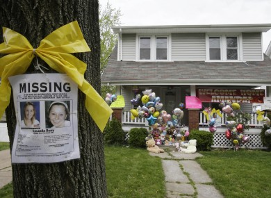 missing poster outside the home of Amanda Berry today