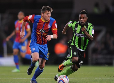 Crystal Palace's Joel Ward (left) and Brighton and Hove Albion's Kazenga LuaLua (right) battle for the ball.